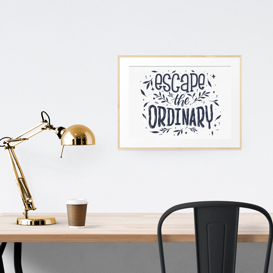 Poster featuring typography 'escape the ordinary' is hung on the wall in a gold photo frame. 200GSM paper, available in A3,A4 size. Landscape poster home decor ideas.