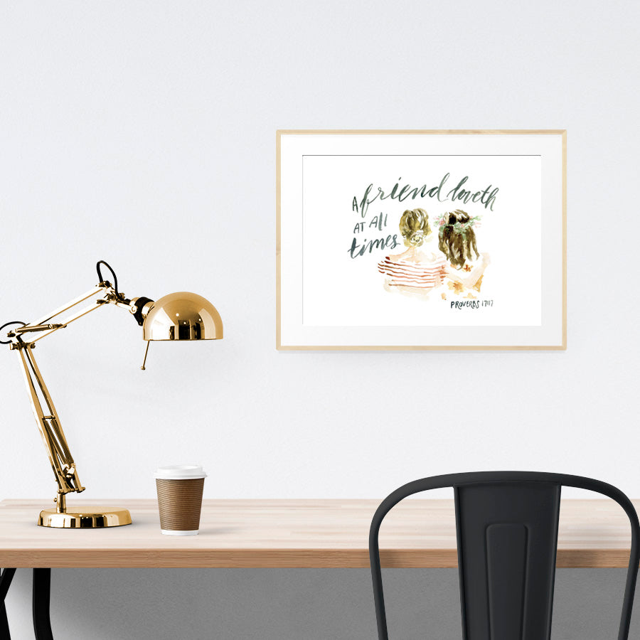 Workspace which is tidy and a landscape wall painting poster depicting friendship between two girls inspired by bible verse from Proverbs 17:17 is hung to give inspiration.