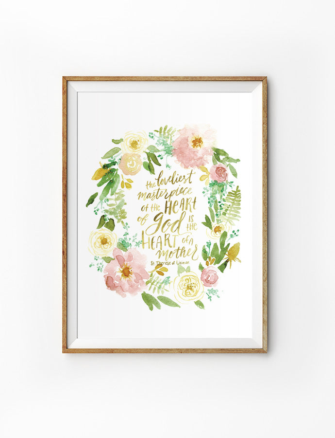 Poster featuring beautiful typography bible verses with flower wreath designs 'the loveliest masterpiece of the heart of God is the heart of a mother' is hung on the wall in a gold photo frame'. 200GSM paper, available in A3,A4 size.
