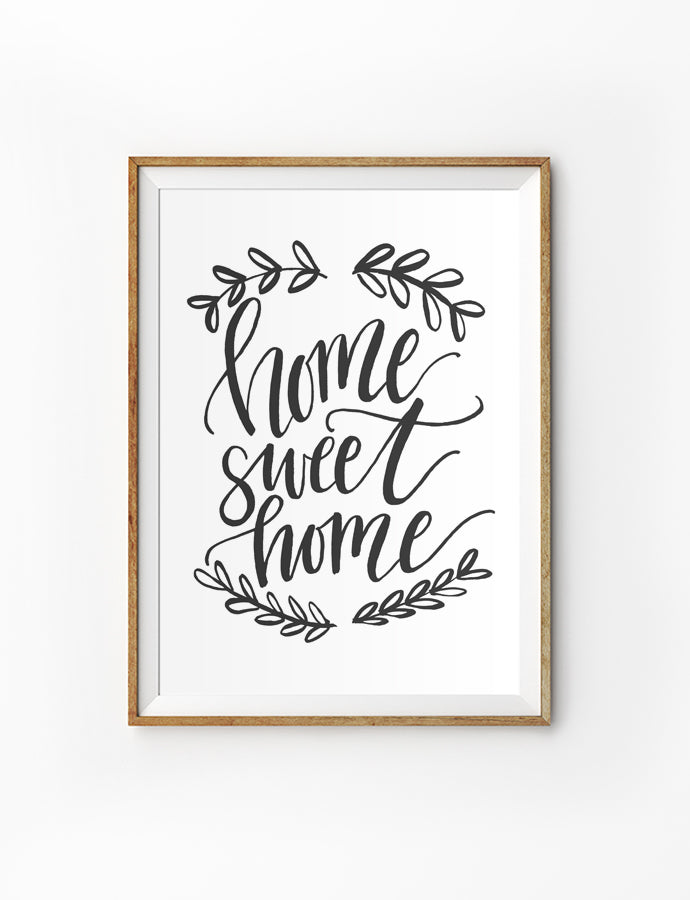 Poster featuring beautiful typography bible verses with wreath designs 'home sweet home' is hung on the wall in a gold photo frame'. 200GSM paper, available in A3,A4 size.