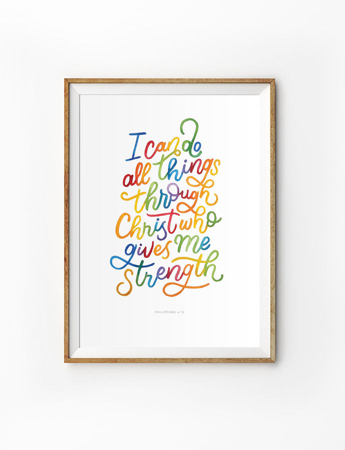 Poster featuring rainbow typography bible verses 'I can do all things through Christ who gives me strength' is hung on the wall in a gold photo frame. 200GSM paper, available in A3,A4 size.