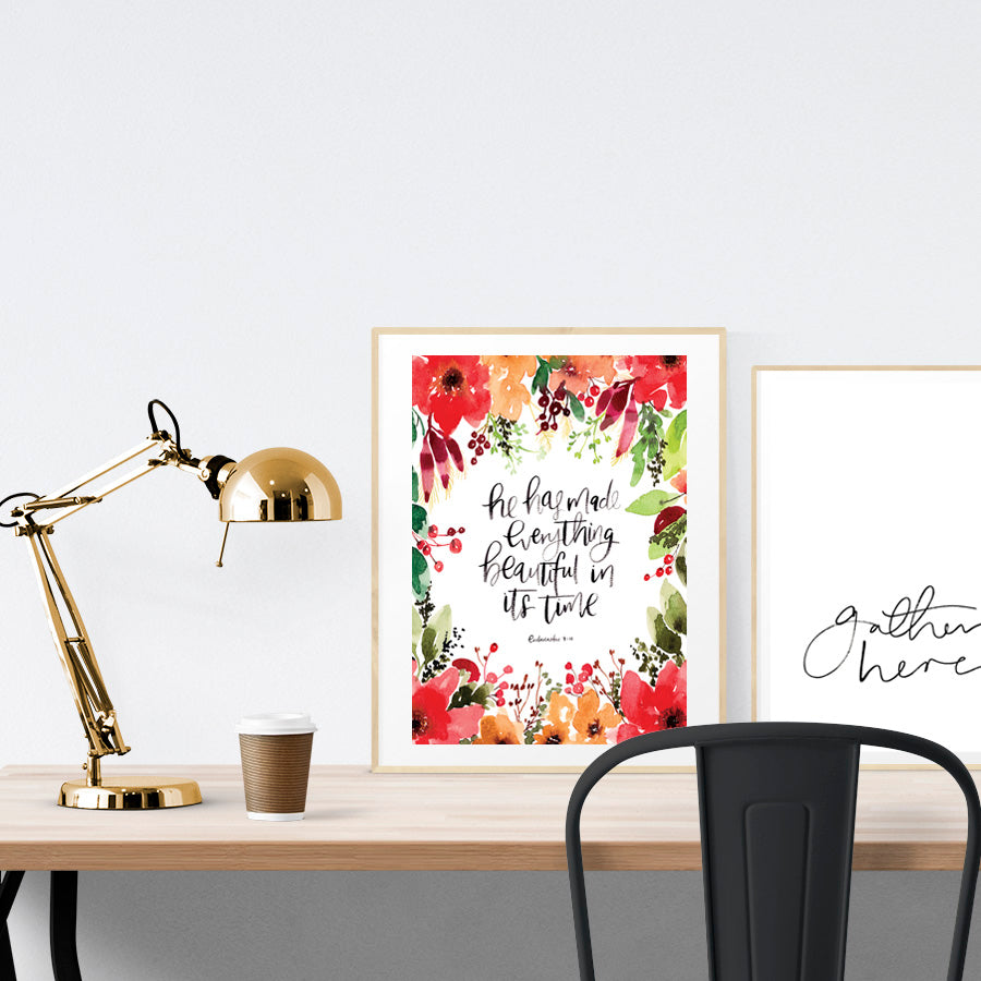 A3 beautiful calligraphy with flowers poster placed standing next to a smaller A4 sized calligraphy poster on a wooden table. Inspiring home decor ideas.