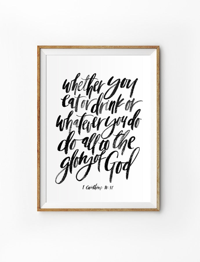 Poster featuring typography bible verses 'Whether you eat or drink or whatever you do, do it all for the glory of God' is hung on the wall in a gold photo frame. 200GSM paper, available in A3,A4 size.