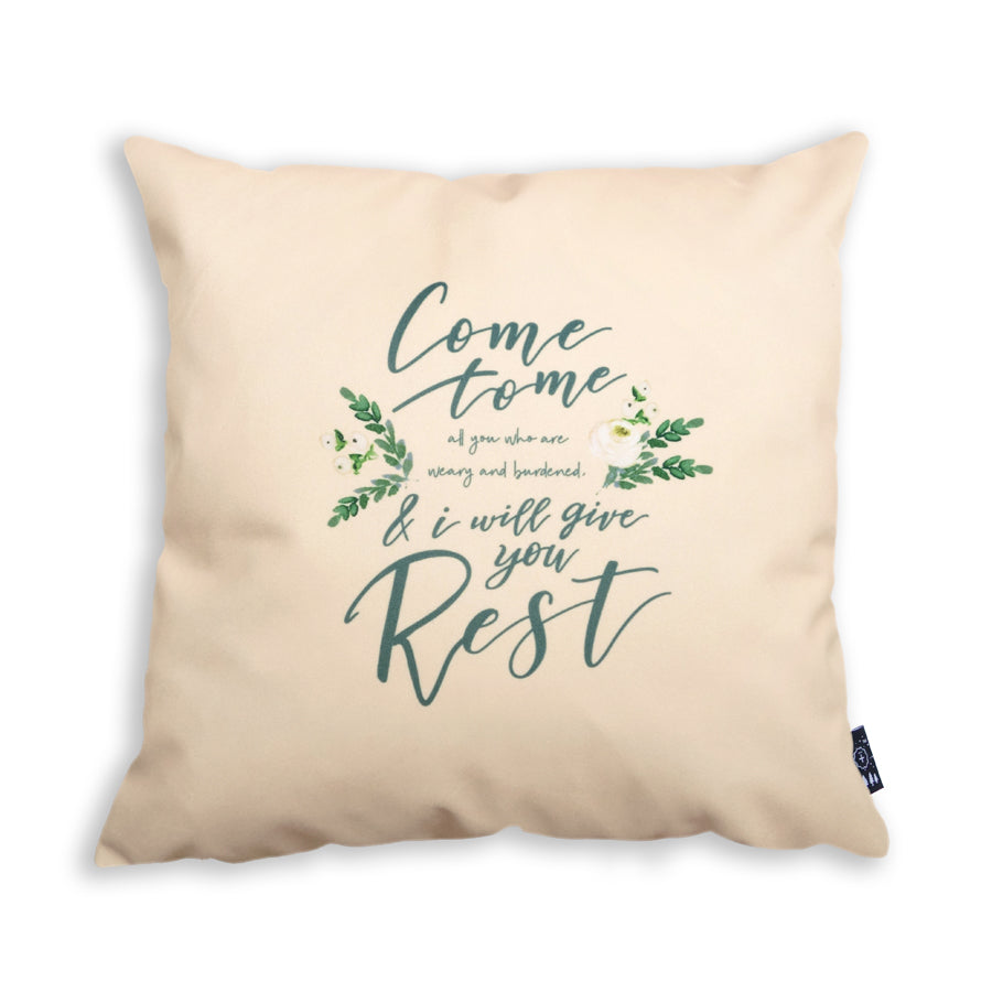 The back of the cushion cover features the same design but the colour of background and font is swapped. The background is now in cream and the font in forest green.