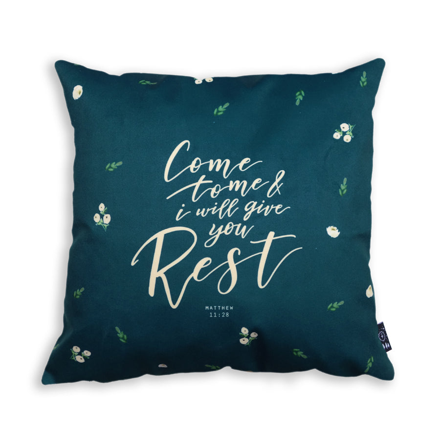 Premium 45cmx45cm pillow cover made of super soft velvet, forest green wooden theme with encouragement bible verse and white tiny flower details. With hidden zip feature. Features verse from Matthew 11:28.