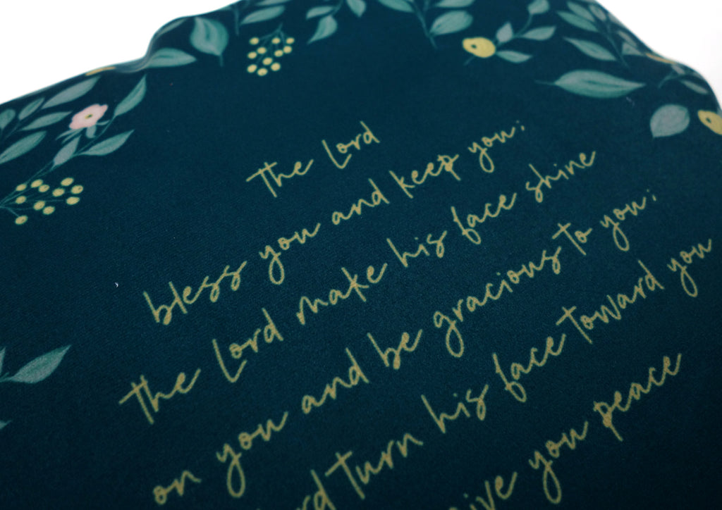Close up of yellow fonts typography at the back of the pillow.