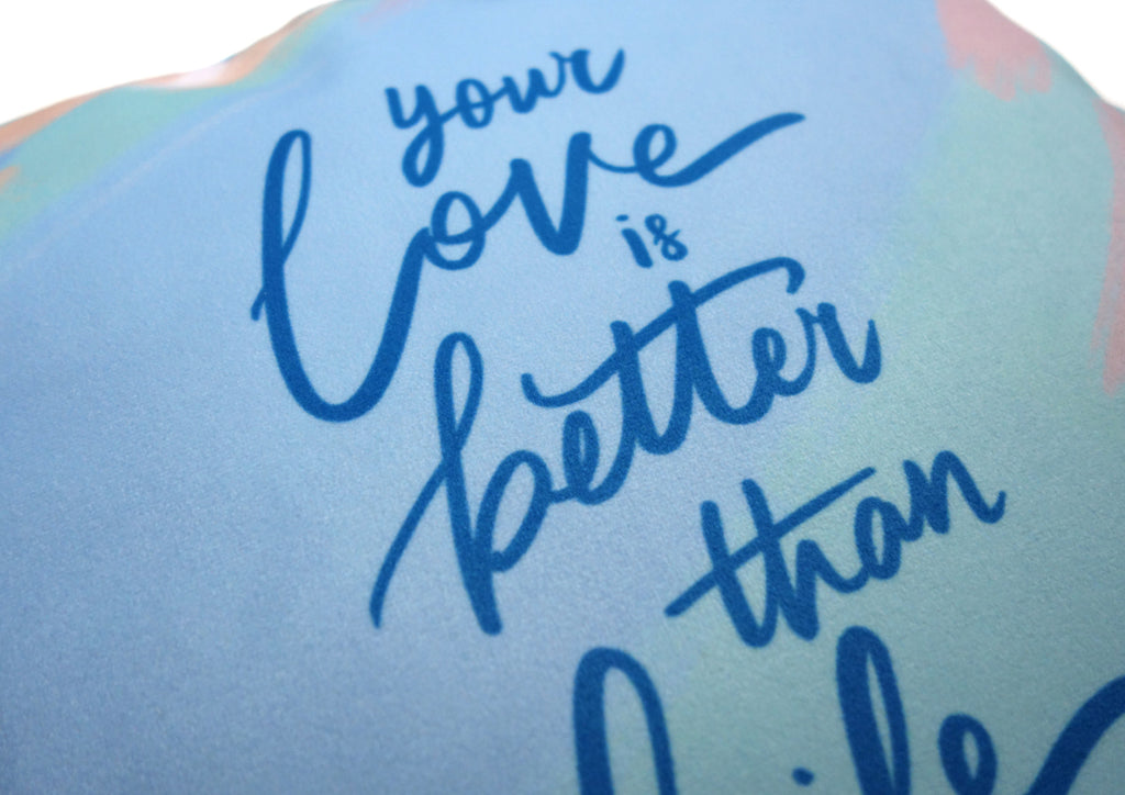 "Close up of the typography letterings ""your love is better than life""."