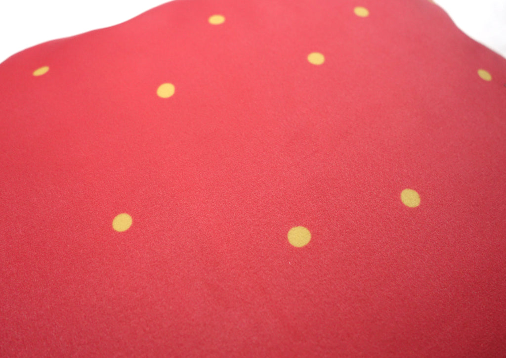 red cushion cover with yellow polkadots