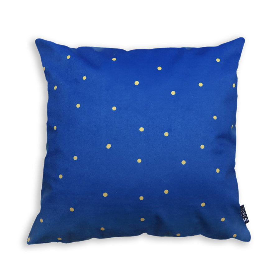 blue cushion cover with yellow polkadots
