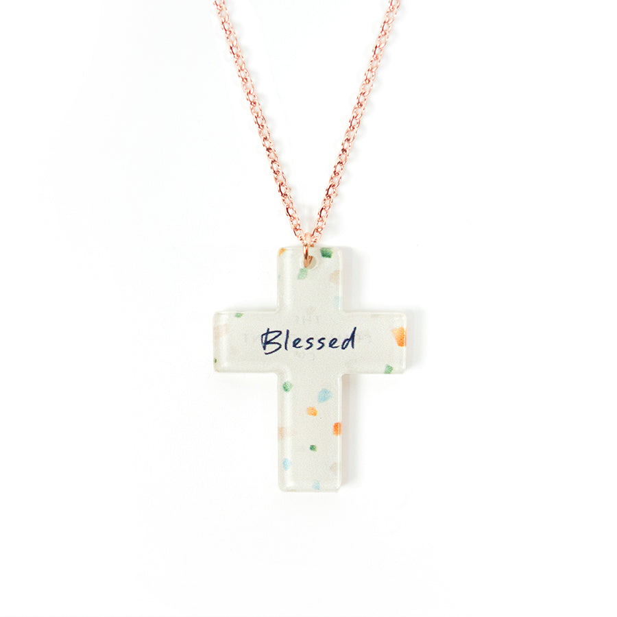 Acrylic off white pendant with abstract designs and encouraging verse 'Blessed' makes for unique gifts. Rose gold plated stainless steel chains. Pendant height 2.7cm length 2.1cm. Chain length 42-46.5cm.