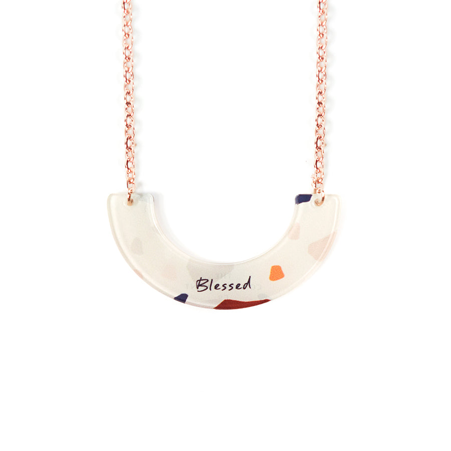 Acrylic U- shaped white pendant with abstract designs and bible verse 'blessed'. This necklace makes for unique gifts. Rose gold plated stainless steel chains. Pendant height 2.1cm length 4.2cm. Chain length 42-46.5cm. Great birthday gift.