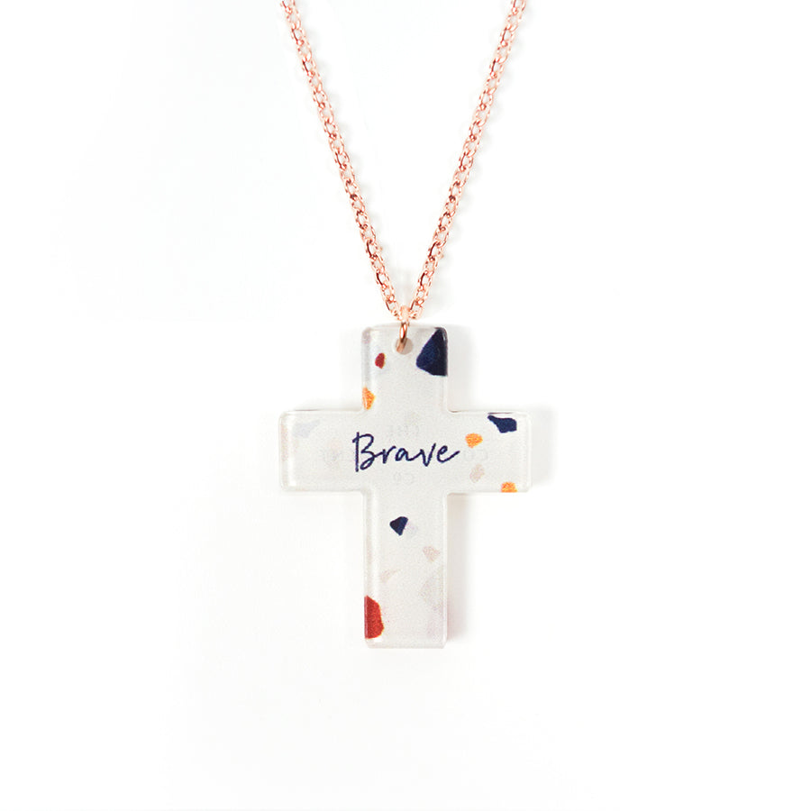 Acrylic off white pendant with abstract designs and encouraging verse 'Brave' makes for unique gifts. Rose gold plated stainless steel chains. Pendant height 2.7cm length 2.1cm. Chain length 42-46.5cm.