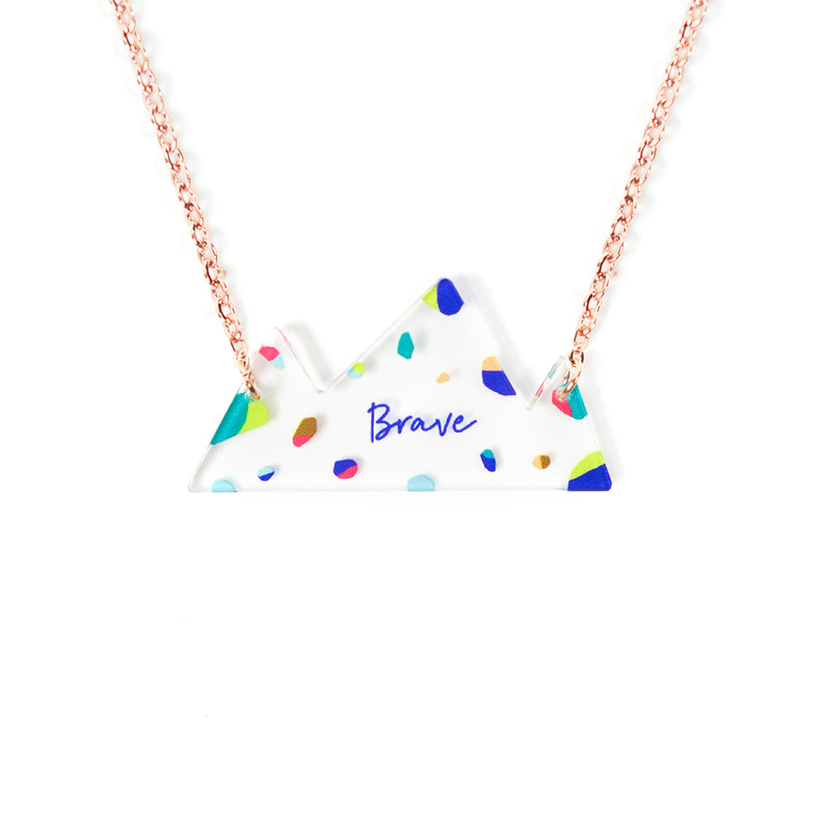 Acrylic mountain- shaped white pendant with abstract designs and bible verse 'brave'. This necklace makes for unique gifts. Rose gold plated stainless steel chains. Pendant height 2cm length 4cm. Chain length 42-46.5cm. Great birthday gift.