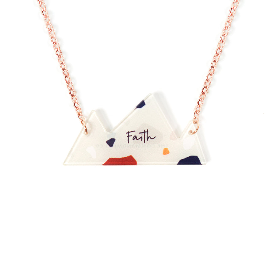 Acrylic mountain shaped white pendant with abstract designs and bible verse 'faith'. This necklace makes for unique gifts. Gifts for friends