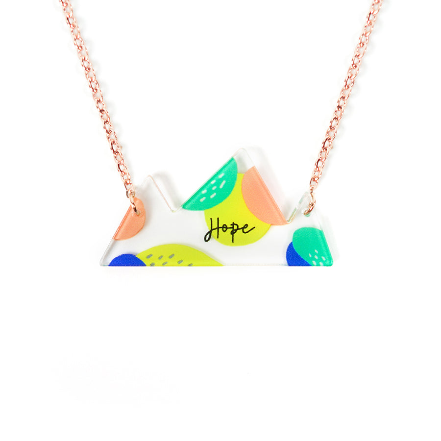 Acrylic mountain shaped pendant with message 'Hope'. This necklace makes for unique gifts for Christian friends or children.