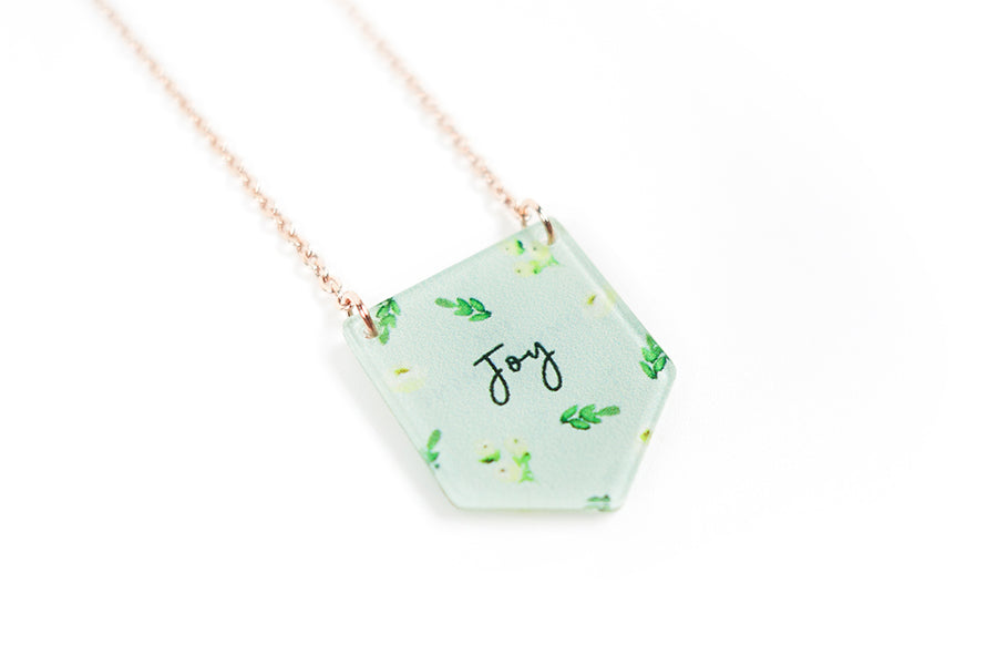 Acrylic banner shaped light green pendant with leaves designs and bible message  'joy'.