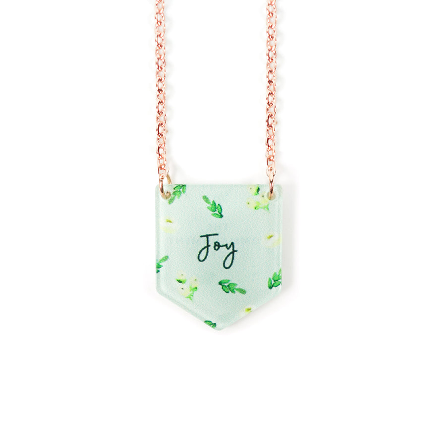 Acrylic banner shaped light green pendant with leaves designs and bible message  'joy'. This necklace makes for unique gifts. Rose gold plated stainless steel chains. Pendant height 2cm length 1.7cm. Chain length 42-46.5cm.