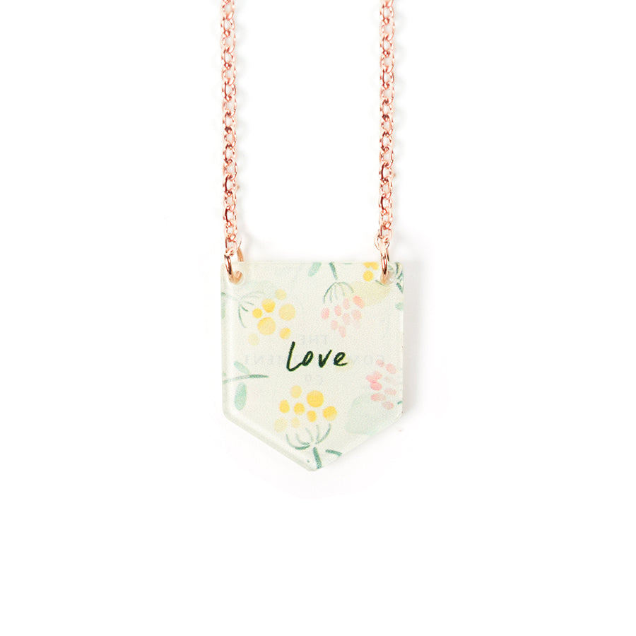Acrylic banner shaped light green pendant with leaves designs and bible message  'love'. This necklace makes for unique gifts. Rose gold plated stainless steel chains. Pendant height 2cm length 1.7cm. Chain length 42-46.5cm.