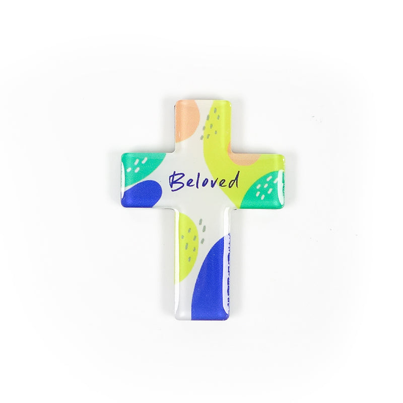 "5cm diameter cross-shaped Acrylic fridge magnet with bible verse ""Beloved"" on transparent background and abstract designs."