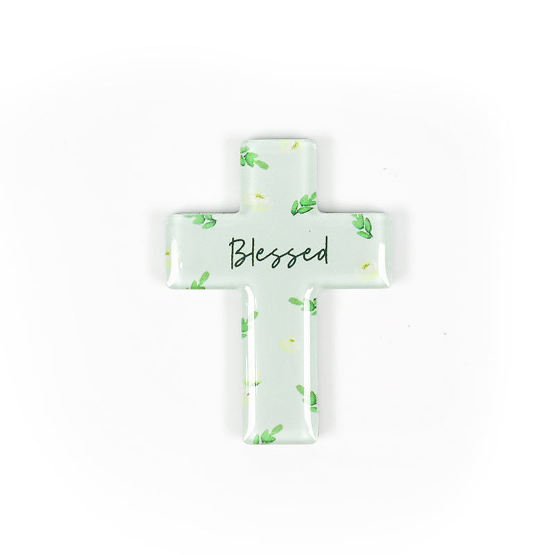 "5.5 cm diameter pastel green cross Acrylic fridge magnet with verse ""blessed"" on garden foliage background."