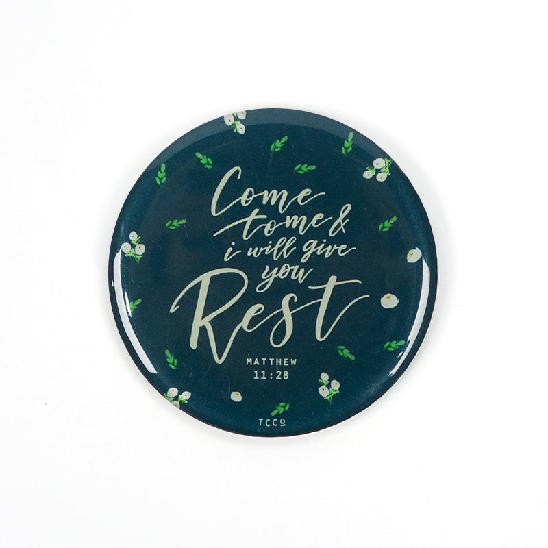 "5.5 cm diameter circular Acrylic fridge magnet with bible verse ""Come to me and I will give you rest"" on foliage background."