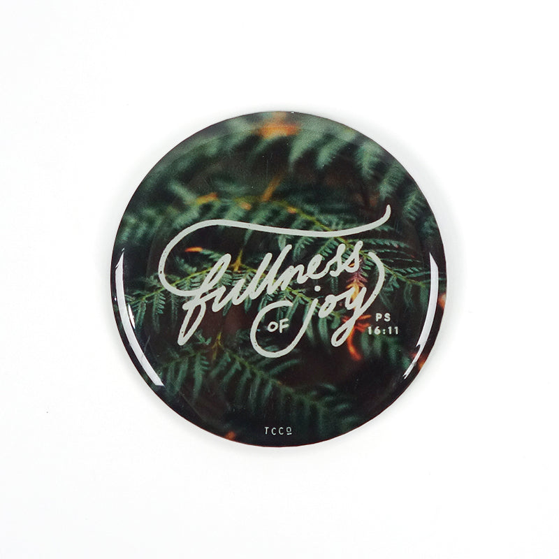 Fullness of joy magnet for fridge. Featuring white font on forest green background