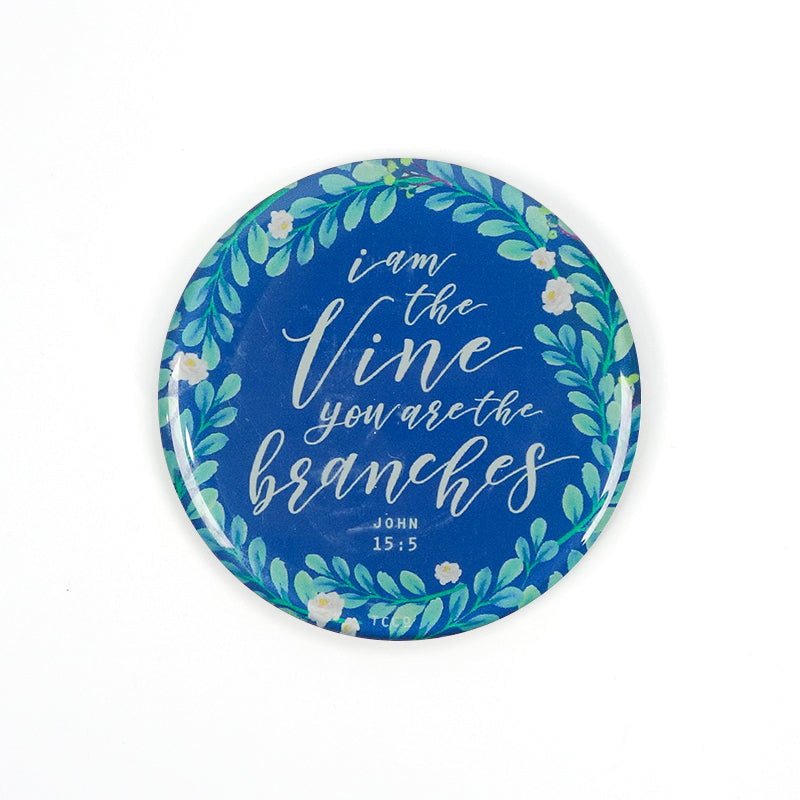 "5.5 cm diameter circular Acrylic fridge magnet with bible verse ""I am the vine and you are the branches"" on foliage background."
