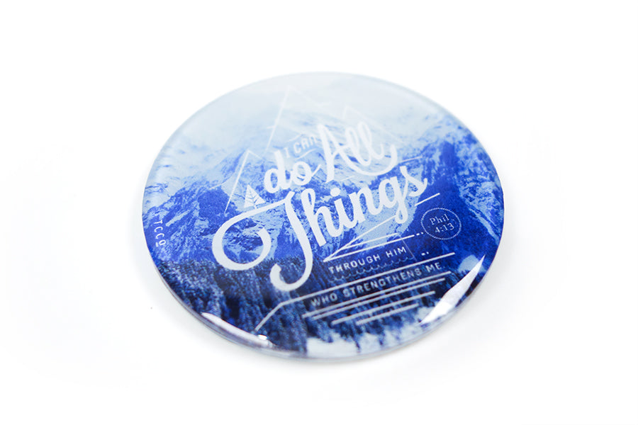 "Close up of 5.5 cm diameter circular Acrylic fridge magnet with bible verse ""I can do all things through Him who strengthens me"" on mountains background."