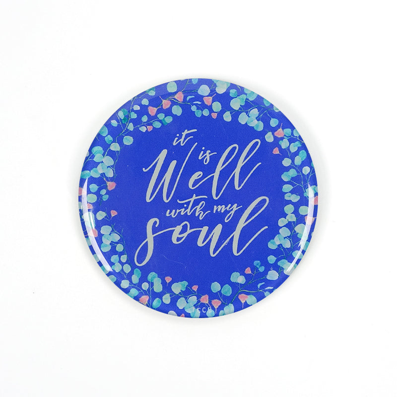 "5.5 cm diameter circular Acrylic fridge magnet with bible verse ""It is well with my soul"" on foliage background."