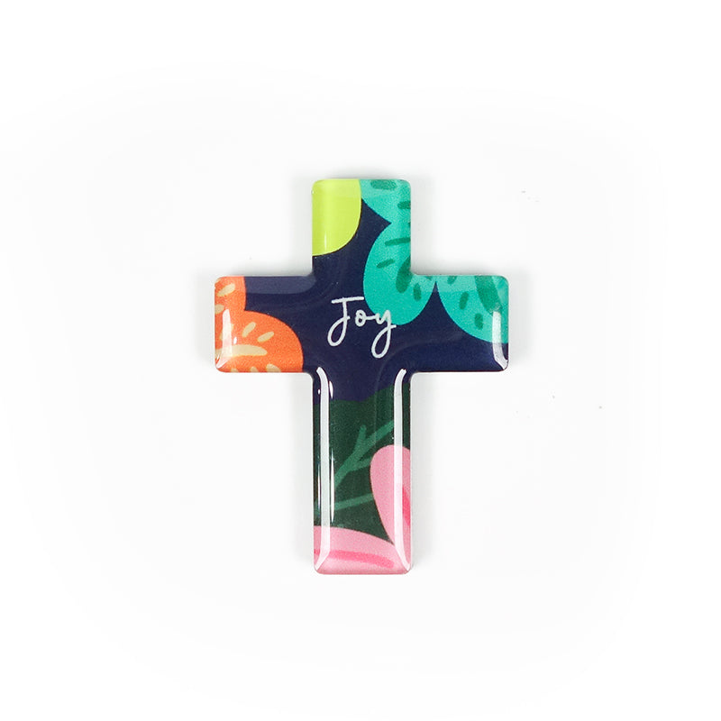 Cross acrylic magnet with colourful floral design. And the encouraging message 'Joy' in white.