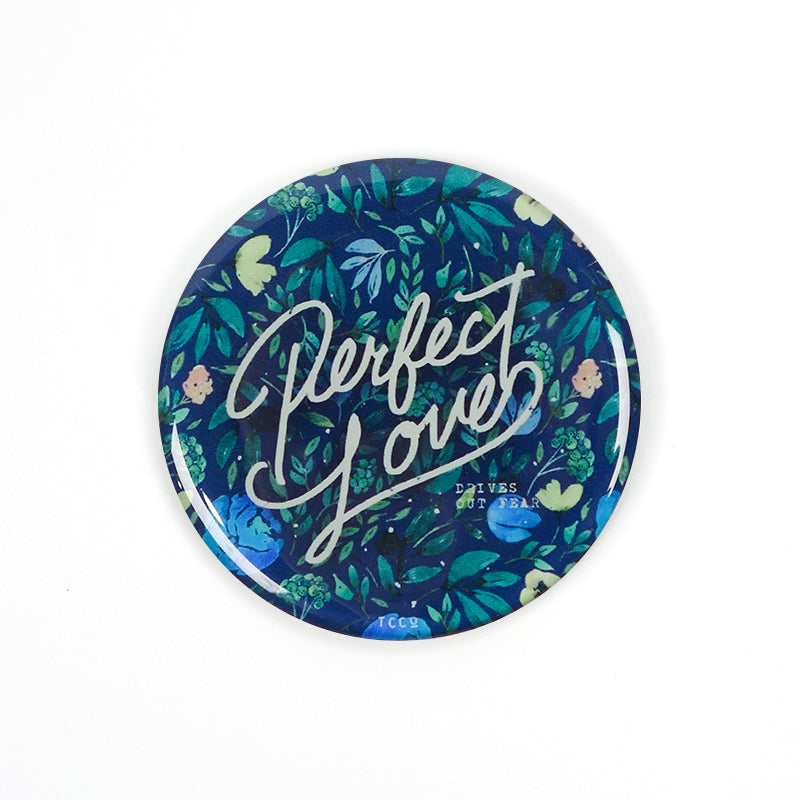 "5.5 cm diameter circular Acrylic fridge magnet with bible verse ""Perfect Love casts out fear"" on foliage background."