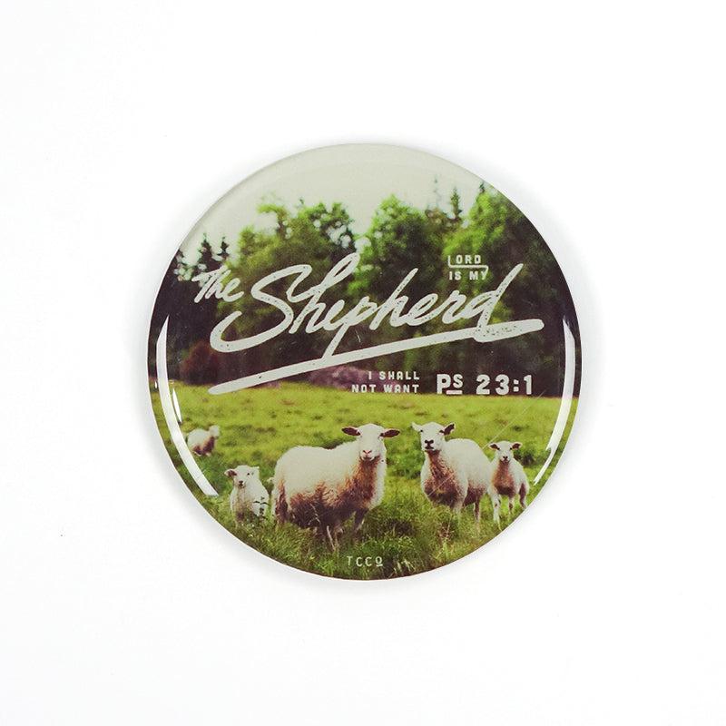 "5.5 cm diameter circular Acrylic fridge magnet with bible verse ""The Lord is my shepherd I shall not want"" on sheep and grassland background."