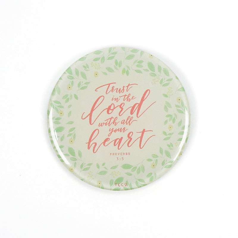 "5.5 cm diameter circular Acrylic fridge magnet with bible verse ""Trust in the Lord with all your heart"" on foliage background."