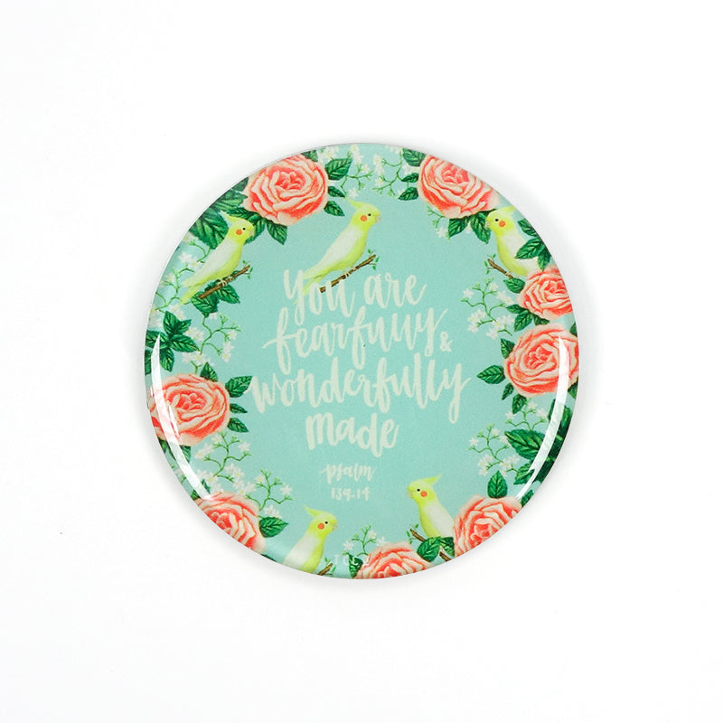 "5.5 cm diameter circular Acrylic fridge magnet with bible verse ""You are fearfully and wonderfully made"" on songbird and flowers background."