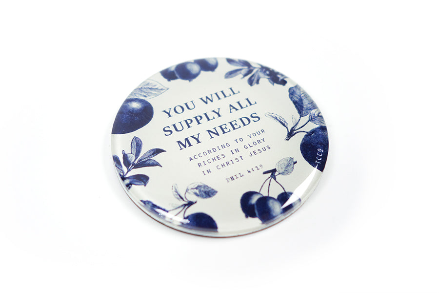 "Close up of 5.5 cm diameter circular Acrylic fridge magnet with bible verse ""You will supply all my needs"" on blue fruits background."