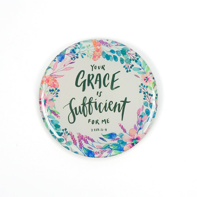 "5.5 cm diameter circular Acrylic fridge magnet with bible verse ""Your grace is sufficient"" on flowers background."