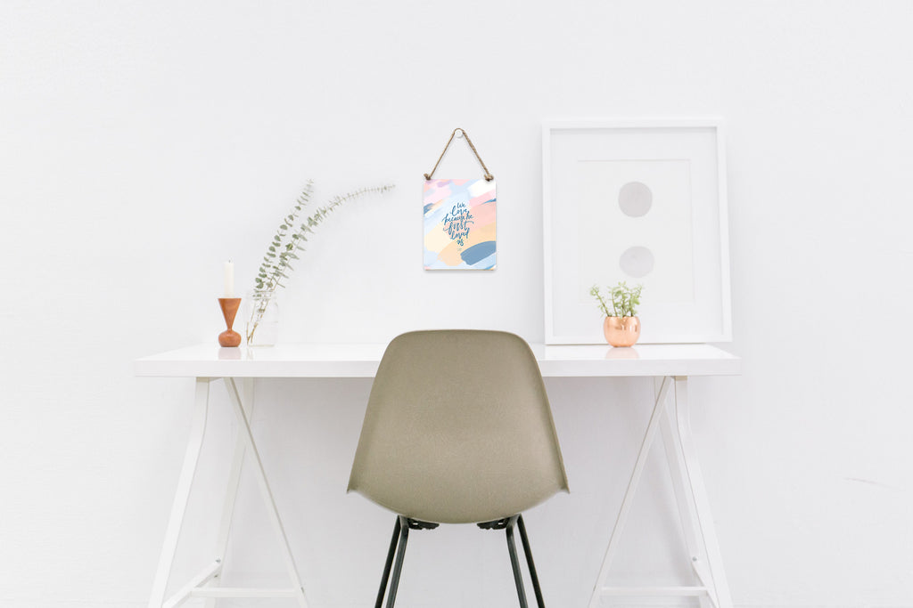 Woodboard hung on PU leather string above a table gives an aesthetic feel to a minimalistic clean workspace.