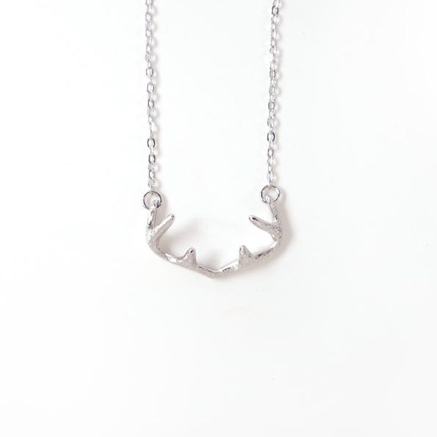 Curved deer antlers necklace, made of coated stainless steel. Pendant Height 1.2cm / Length 2.4cm Chain Length 40cm - 44.5 cm