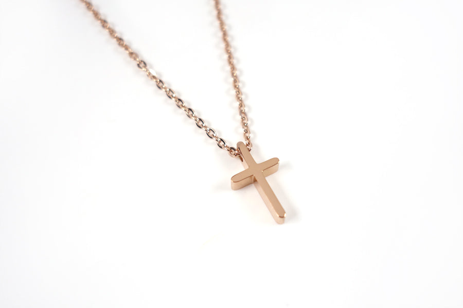 Side view of Rose Gold cross necklace - Rose Gold Plated Stainless Steel  Measurements: Pendant Height 1.4cm / Length 0.8cm Chain Length 16cm - 19.6cm