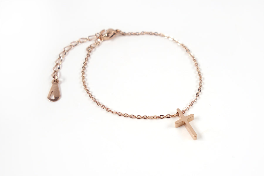 Top view of Rose Gold cross necklace - Rose Gold Plated Stainless Steel  Measurements: Pendant Height 1.4cm / Length 0.8cm Chain Length 16cm - 19.6cm