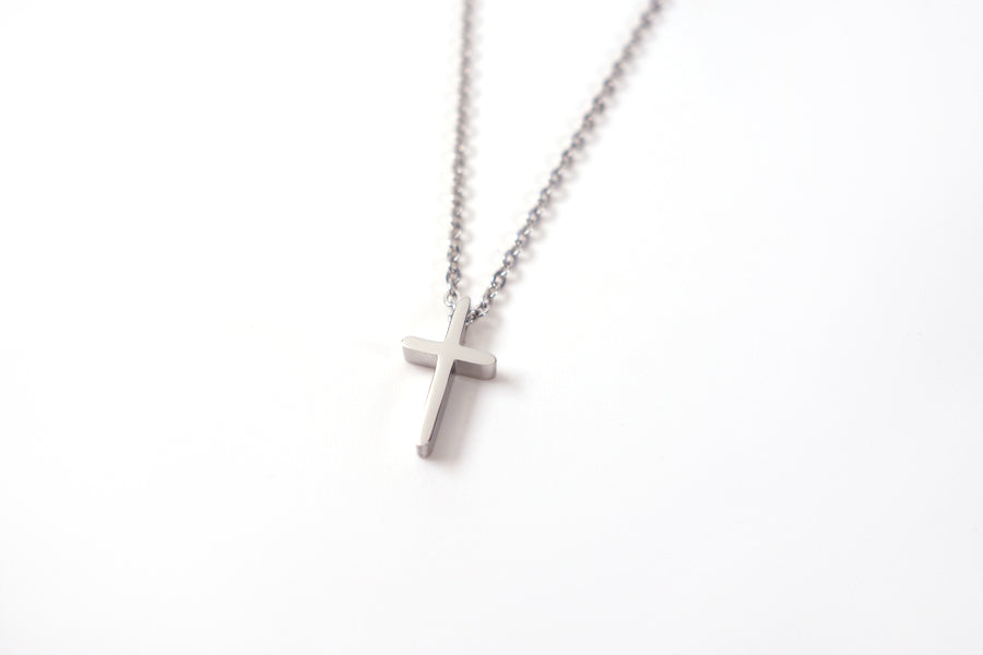 Side view of Silver cross pendant- Stainless Steel  Measurements: Pendant Height 1.4cm / Length 0.8cm Chain Length 16cm - 19.6cm