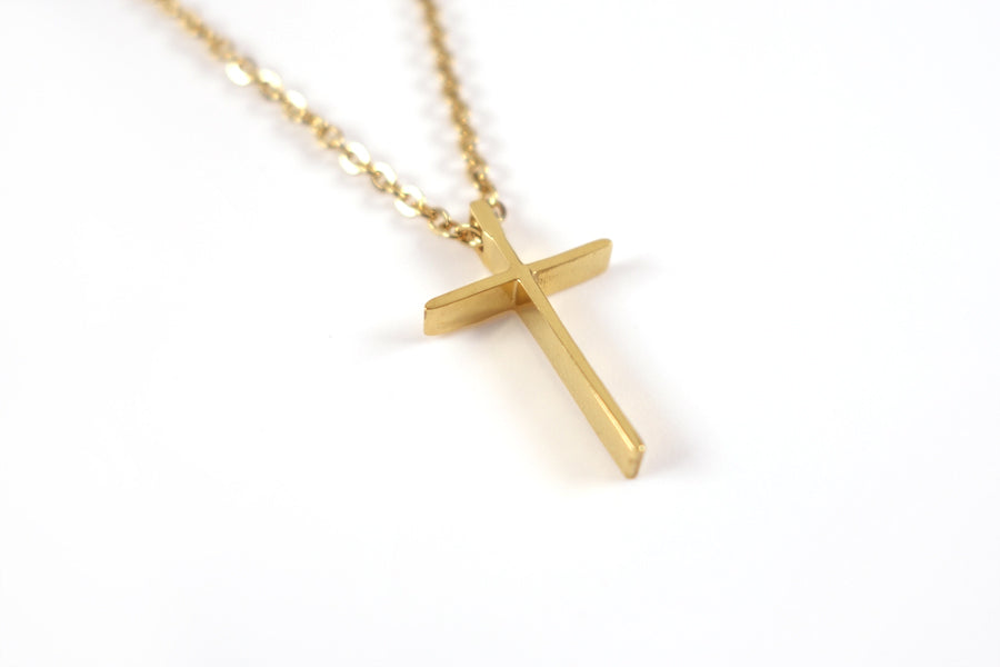 side view of Gold color cross pendant