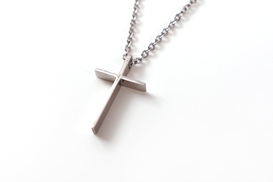 Side view of silver cross pendant