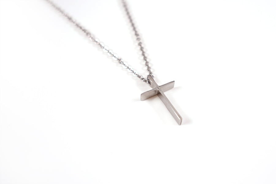 Close up of silver cross pendant for silver cross necklace