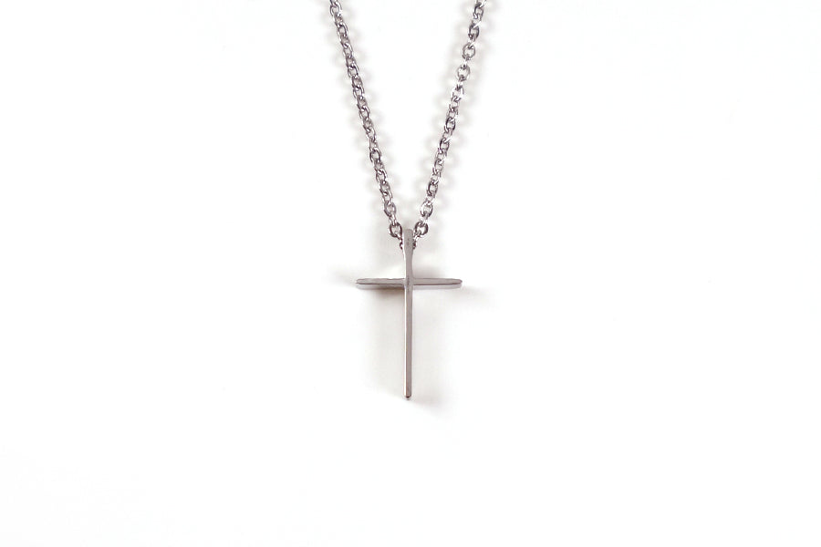 Silver Colour cross necklace. Made of Stainless Steel.  Measurements: Pendant Height 1.8cm / Length 1.1cm Chain Length 44cm