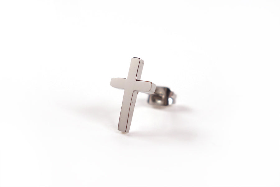 Close up of one Silver Cross Earring- S925 Silver Plated. Measurements: 12mm Earring Post Length, 7mm Cross Width, 12mm Cross Length. Includes hypoallergenic clear rubber barrel clutches & S925 plated stainless steel push back