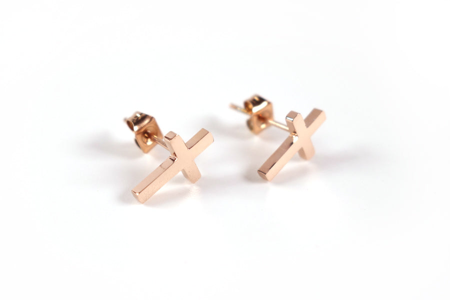 Side view of Rose Gold Cross earrings - S925 Rose Gold Plated. Measurements: 12mm Earring Post Length, 7mm Cross Width, 12mm Cross Length. Includes hypoallergenic clear rubber barrel clutches & S925 plated stainless steel push back