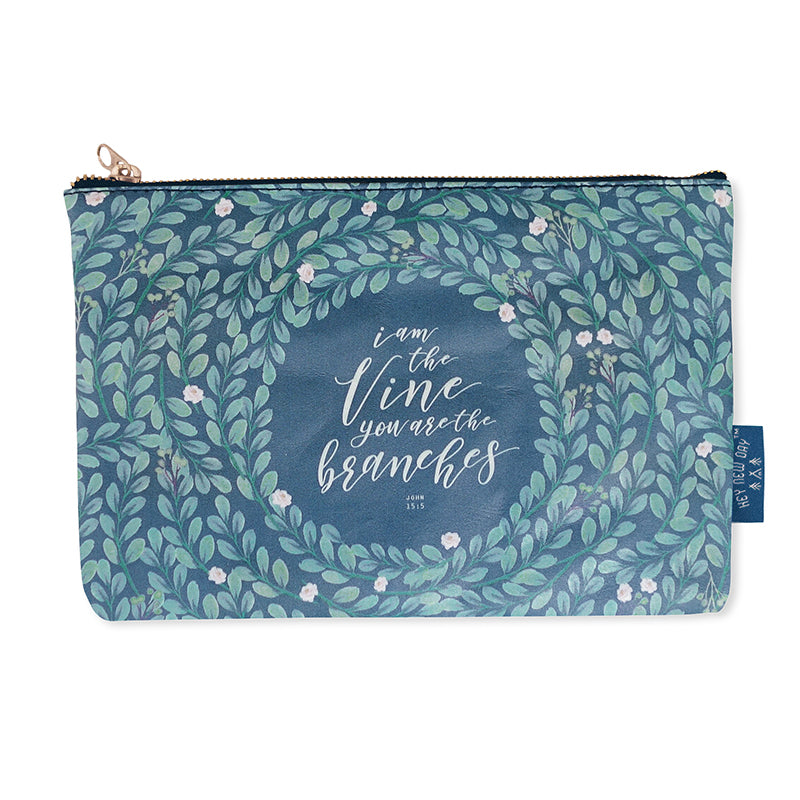 Multipurpose PU Leather pouch in blue with foliage designs on it. Features bible verse 'I am the vine and you are the branches ' in white lettering and is great Christian gift idea. The pouch has inner lining, gold zip. Dimensions: 21cm (W) x 14cm (H)