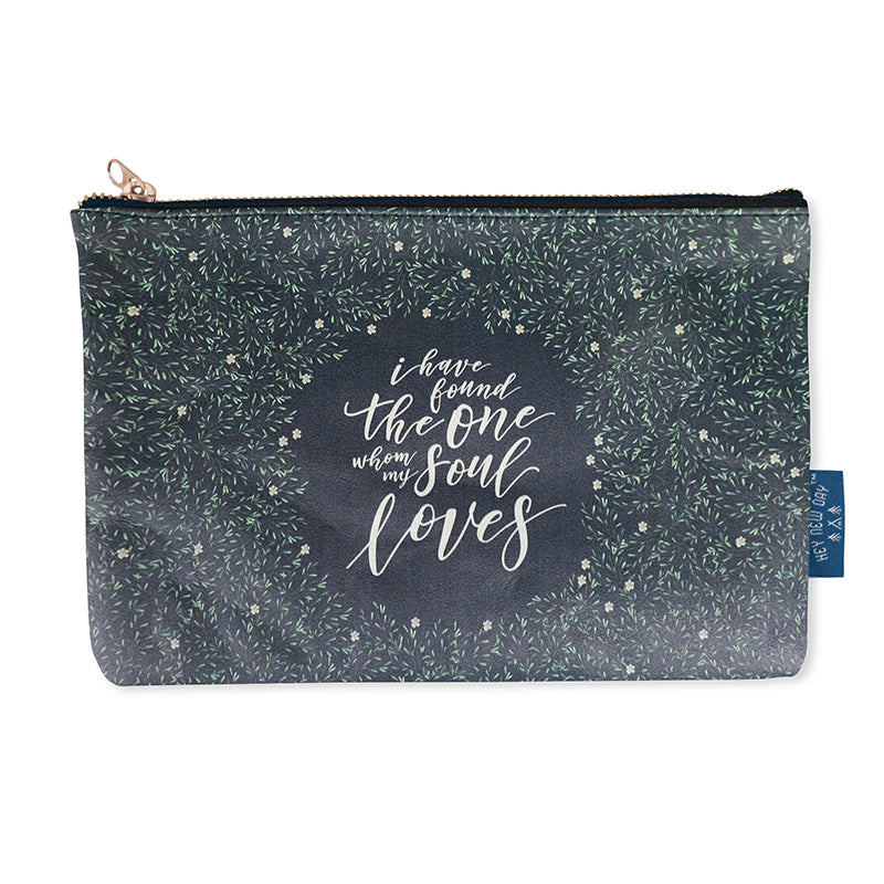 Multipurpose PU Leather pouch in blue with mini flowers designs on it. Features bible verse 'I have found the one whom my soul loves' in white lettering and is great Christian gift idea. The pouch has inner lining, gold zip. Dimensions: 21cm (W) x 14cm (H)