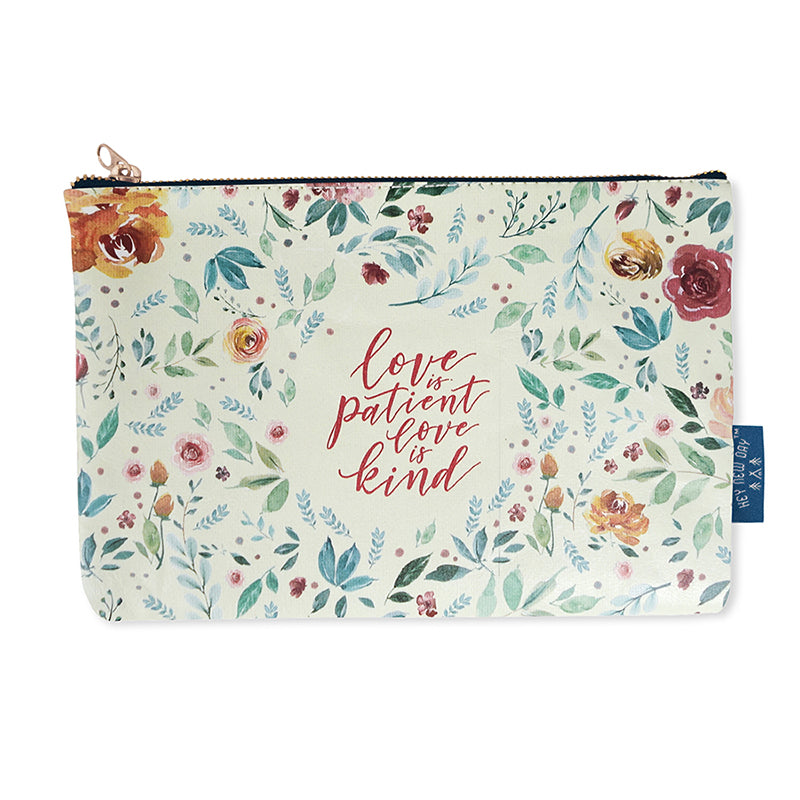 Multipurpose PU Leather pouch in cream with garden designs on it. Features bible verse 'Love is patient, love is kind ' in white lettering and is great Christian gift idea. The pouch has inner lining, gold zip. Dimensions: 21cm (W) x 14cm (H)